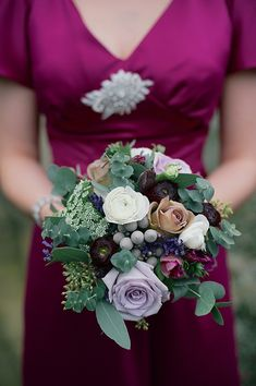 Something wintery- berries and frosty looking foliage like eucalyptus and anemones, ranunculus, amaryllis and ornamental cabbage.