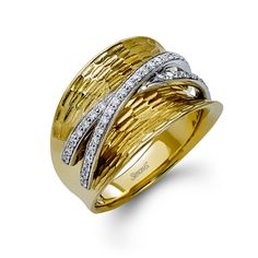 Fabled Collection - This fabulous 18K white and yellow ring is comprised of .30ctw round white Diamonds.   - LP2103