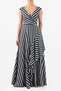 Our stripe cotton knit dress is fashioned with a pleated cross-over bodice and a cascading diagonal ruffle across the long flared skirt for flutter asymmetry.