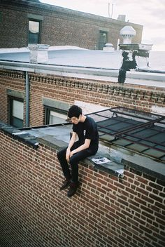 Sitting on roofs.