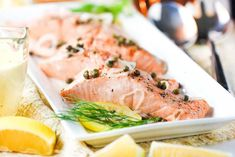 Poached salmon with capers and dill on a platter Salmon With Capers Recipe, Recipe For Poached Salmon, Party Entrees, Elegant Dinner Party, Lemon Salmon, Hollandaise Sauce, Salmon Dishes, Quick Weeknight Meals, Salmon Fillets