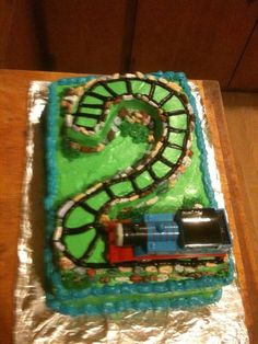 Thomas cake first edition. I love using chocolate rocks they ad so much realism. This was one of my favorites until I discovered fondant. Thomas cake has since evolved into something new. But for this guys second birthday it was perfect.