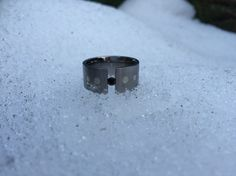 Stainless steel ring with tension set black gem and silver inlay