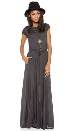 This crew-neck jersey maxi dress features ribbed banding and ruching at the covered elastic waistband.