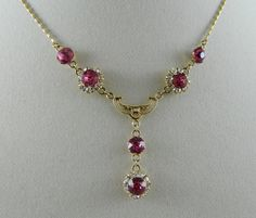 Vintage necklace vintage jewelry 10kt GOLD FILLED pink stones white rhinestones unique chain stunning. $30.00, via Etsy.