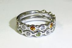 Two white gold stackable rings, one with Peridots and the other with Citrine