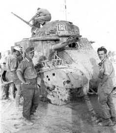 German soldiers inspecting a destroyed tank of the 1st Armored Division, 1942