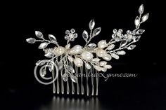 hair jewelry A simple, silver wedding hair comb with sprays of ivory freshwater pearls and marquise rhinestones accented by a few rhinestone flowers. It is inches long and inches high. Hair Comb Wedding, Headpiece Wedding, Bridal Hair, Hair Jewelry, Wedding Jewelry, Jewellery, Simple Wedding Hairstyles, Long Brown Hair, Hair Ornaments