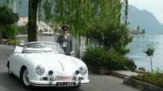 Picture of my husband with out austrian police car.  2009 in Switzerland (at this stage we had lights wrong)