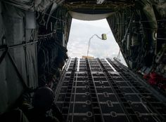 Loadmasters with the 36th Airlift Squadron deploy a low-cost, low-altitude payload in a C-130 Hercules April 23, 2014 over the Republic of Korea. The sortie took off in support of Max Thunder, a bilateral aerial training exercise that trains U.S. and Republic of Korea Air Force pilots to work closer together against a hostile force. (U.S. Air Force photo by Staff Sgt. Chad C. Strohmeyer/Released)