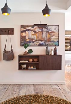 love the idea of a suspended entry cabinet, very unique and clean