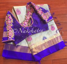 Beautiful designer saree and purple designer blouse with hand embroidery thread work.