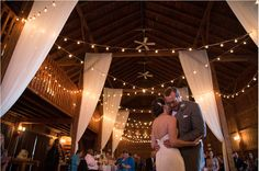 First dance at the Barns at Wesleyan Hills! Garden lights and opulent sheer fabric decor. Jewel Photo, August 2015