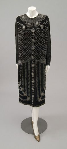 Woman's Dress and Underdress  Made by l'Etoile Filante, Paris  Date: 1920s Medium: Black silk crepe; clear glass beads  Accession Number: 2009-34-1a,b
