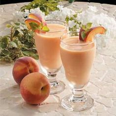 "Peachy Fruit Smoothies Recipe -The color of this refreshing beverage just says ""Spring!"" Smoothies are great for breakfast, dessert or a midday snack. Fruit Smoothie Recipes, Yummy Smoothies, Juice Smoothie, Smoothie Drinks, Yummy Drinks, Healthy Drinks, Healthy Snacks, Healthy Recipes, Locarb Recipes"