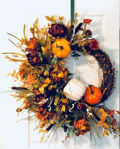 Enjoy the Autumn season with this beautiful Fall Pumpkin wreath! The gorgeous florals include burgandy and golden rananculus, Chrysanthemums and mixed fall greeneries,! It has white and orange pumpkins.this wreath is inches. Thanksgiving Wreaths, Autumn Wreaths, Christmas Wreaths, Cozy Christmas, Diy Wreath, Wreath Making, Door Wreaths, Harvest Decorations, Fall Bouquets