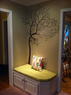 Reading bench..........like the tree...might have to do that for my kids reading nook.