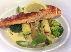 Grilled periperi salmon with steamed vegetables in chilli-butter sauce.  Bon appetit :)