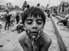 Do you love my expressions? The Kid seems to be really good at them. Sitting on the banks of River Ganga, he is making most of his time posing for the shutterbug  #people #kid #expressions #blackandwhite #Ganga #River #photography #privilegemomentsMB