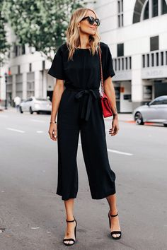 Fashion Jackson Wearing Everlane Black Tie Waist Jumpsuit Chanel Red Handbag Black Heeled Sandals Source by mangellipodevin outfit Jumpsuit Denim, Black Jumpsuit, Casual Jumpsuit, Summer Jumpsuit, Black Culottes Outfit, Jumpsuit Style, Style Noir, Mode Style, Jumper Outfit Jumpsuits