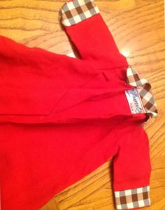 Red Faerie Glen coat with black and white check trim