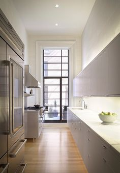 love this kitchen, especially the back door/window