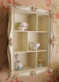 Cream ornate wall shelving unit, beautiful, have seen this idea for a jewelry cabinet in an up cycle idea and one that you can buy, but a bit pricy, so will be making my own. Lvly for the bathroom, or any where in the house really.