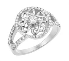 The dazzling center diamond of this gorgeous 10k and 14k White Gold Celtic Wedding Ring is surrounded by a gleaming gold Celtic Trinity Knot that is framed by a circle of sparkling smaller diamonds which then extend along the sides of the center piece, adding up to 74 diamonds weighing at 0.74ct. The center precious stone has an approximate weight of 0.25ct (between 0.23ct and 0.27ct). All the diamonds are of vs2 quality! Made in the USA. Sizes: 4-12 (including half sizes).
