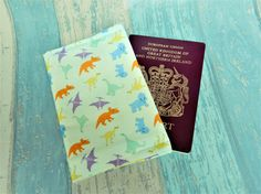 Dinosaur passport cover  dinosaur passport wallet  dinosaur Make A Dinosaur, Dinosaur Gifts, Passport Wallet, Passport Cover, Travel Gifts, Have Some Fun, Printing On Fabric, Unique Gifts, How To Draw Hands