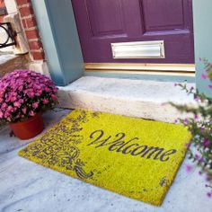 Doormat that says Welcome with scrolly flowers - green and purple - 17 in. x 28 in. Non Slip Coir Door Mat - Purple Welcome - P971 by Entryways