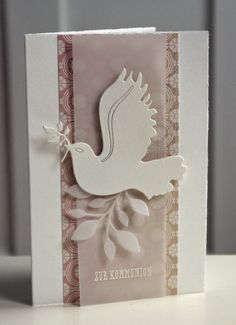 handmade Christmas card from Blütenstempel ... lovely neutral patterned paper with white ... die cut peace dove on leafy branch ... luv the layout with a raised column of translucent vellum down the center of a wider band of patterned paper ...