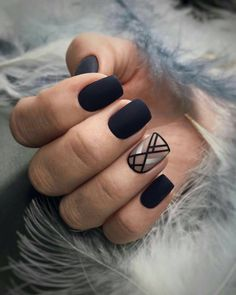 Black matte nails with negative space geometric accent nail. ― re-pinned by Breanna L. ~Follow me and never miss a new nail design!~