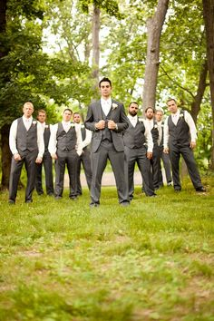 Groom in 3-piece. Groomsmen in pants/vest only. Suits from K.