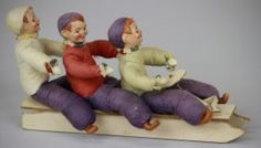 Three boys on a large sled.