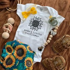 Sunflower Baby Girl Onesie Baby Shower Gift Pregnancy Announcement Baby Clothes This sunflower shirt is perfect for baby girl outfits, baby shower gifts, pregnancy announcements, and more. We also have a mama shirt to match! Baby Outfits, Kids Outfits, Baby Boys, My Baby Girl, Baby Girl Onesie, Baby Girl Stuff, Cute Baby Onesies, Baby Girl Shirts, Camo Baby Stuff