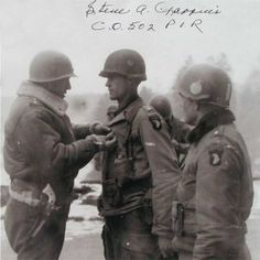 Patton...presenting medal to a paratrooper from the 101st Airborne.