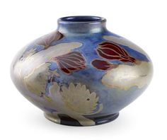 ZSOLNAY  BALUSTER VASE, CIRCA 1905  'Eosin' glazed earthenware, squat baluster form, decorated with a freize of flowering plants, impressed and printed marks 'Zsolnay Pecs' 5092  18cm high 08/E3,25eL