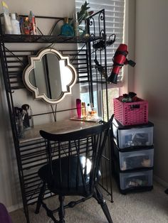 DIY Vanity Small Space Solution - A Vanity out of a reclaimed bakers rack.  Rack - Free Used  Mirror - $9 TJ Maxx - I hung it on the back of the rack with fishing line.  Blow dryer Rack - $9 TJ Maxx  3 Square Vases (for Makeup Brushes and Eyeliners) $12 TJ Maxx  Rolling Drawer Cart for Makeup - $16 Lowes  Pink Basket - Had on hand  Chair - had on hand old dinning room chair.