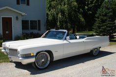 1970 Cadillac convertible. newer working top. new dual exhaust. white pearl driver quality paint. 472. new carb. . auto trans. new shocks. new brakes. top works. 22 inch wire wheels. tires good . interior decent. good driver. clean title in hand. recent alignment.  Will include the good stock wheels and tires.  This car is up for sale with NO RESERVE!!!! If you're bidding. you cou