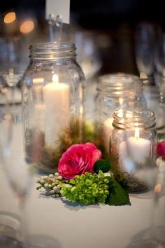 @Megan Welch, a great way to add color to mason jar candles, place a few flowers around the candles. I think hydrangeas would look great with some lavender and a little greenery.