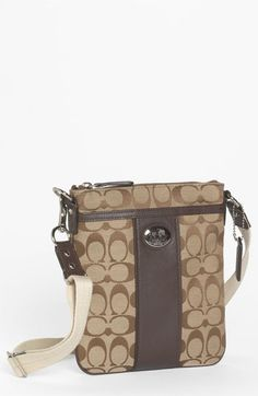 Very Iconic:)This modern purse looks best when it hits right at your hip! COACH 'Sutton Signature Swingpack' Crossbody Bag, $128; shop.nordstrom.com