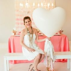 A punchy coral and gold palette with girly touches like ruffles, balloons, and streamers! {Image by Liz Banfield via Style Me Pretty}