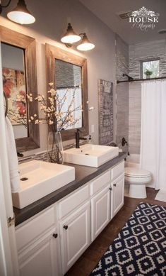 Love the rustic accents, elegant white sinks and cabinetry and the gray back splash in the shower!