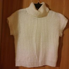 Soft Cream Acrylic and Wool Sweater Short sleeved turtle neck soft cream and acrylic sweater. Size Large but could fit a Medium. Saywhat Sweaters Cowl & Turtlenecks