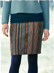 The short pima skirt is jacquard knit in traditional manta stripes of teal, midnight, copper and raisin.