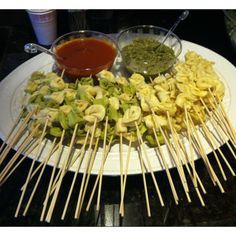 Tortellini skewers with pesto and marinara dipping sauce