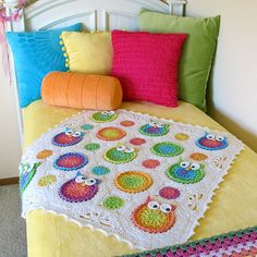 Ravelry: Owl Obsession pattern by Marken of The Hat & I - forget the owls, I like the different sizes of circles in the one blanket