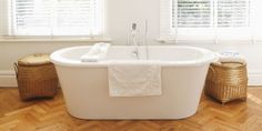 A freestanding tub looks a lot less plain thanks to decorative baskets. Use them to hold towels or swap in a pair of ceramic stools for added color.    Shop a similar look: storage baskets, $120, amazon.com
