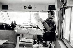 Clint Eastwood reads a newspaper between takes while making the western Joe Kidd, 1972 Photograph: Terry O'Neill/Iconic Images Photographer Terry O'Neill: a life in pictures Terry O Neill, Jennifer Jones, Jean Michel Basquiat, Raquel Welch, Jackson Pollock, Wassily Kandinsky, Hollywood Stars, Classic Hollywood, Hollywood Images