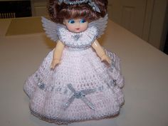 Angel Doll is an air freshener. You can use it in any room of your house.  I crochet the dolls in all colors. This doll has silver trim with silver wings. She could also be made with gold wings and gold trim This does not have pattern for dress.